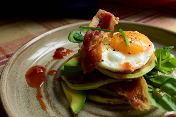 Our chef's special fluffy pancakes, served with crispy bacon, free range eggs, avocado and yoghurt, served with fresh chives and chilli jam.