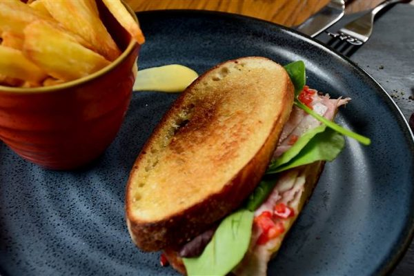 Our roasted sandwiches start with freshly baked Rooster's bread, sliced honey roasted ham and semi soft Ardrahan cheese, tangy pickles, salad greens, tomatoes and fresh peppers, dressed with homemade mayonnaise.