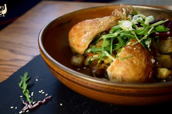 Slow-cooked Rooster's style roasted chicken dish, served with seasonal root vegetables & potatoes, tasty and good for you!